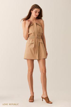 Платье песочного оттенка с накладными карманами фото