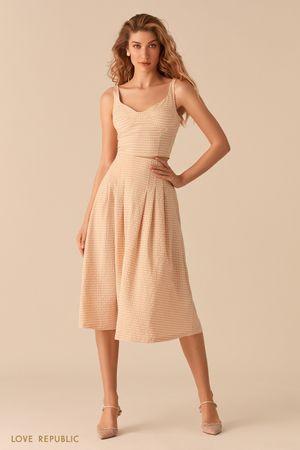 Пышная юбка-миди из вафельной бежевой ткани с принтом