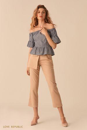 Укороченные бежевые брюки с отстегивающимся наружным карманом фото