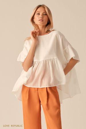 Свободная белая блузка с удлиненной спинкой фото