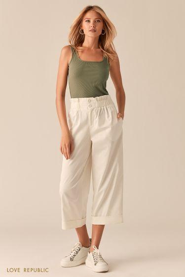 Укороченные широкие брюки с подворотами белого цвета 0256204729
