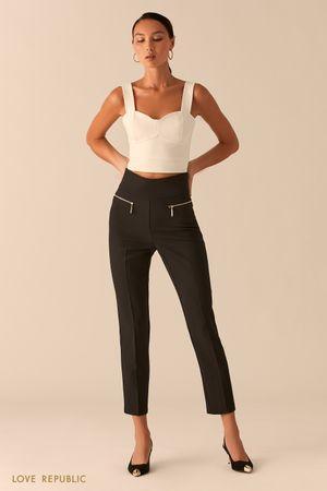Черные зауженные брюки с карманами на молниях фото