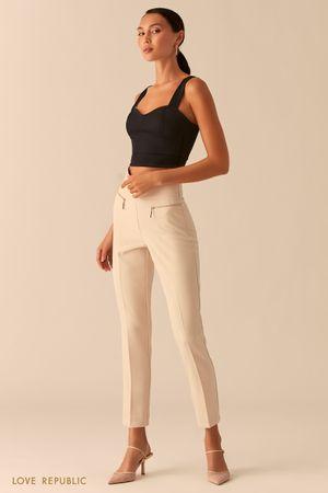 Зауженные брюки с карманами на молниях кремового цвета фото